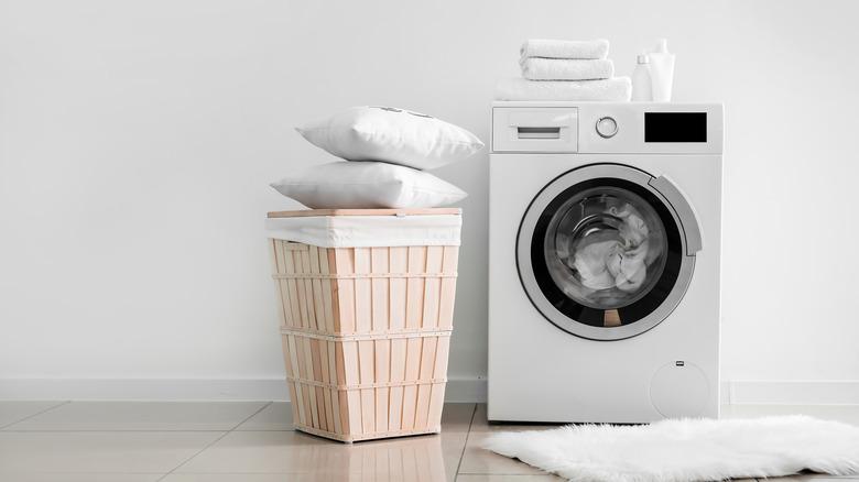 Pillows next to a washing machine