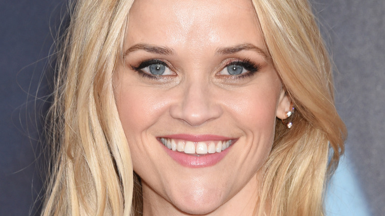 Reese Witherspoon smiling at a movie premiere