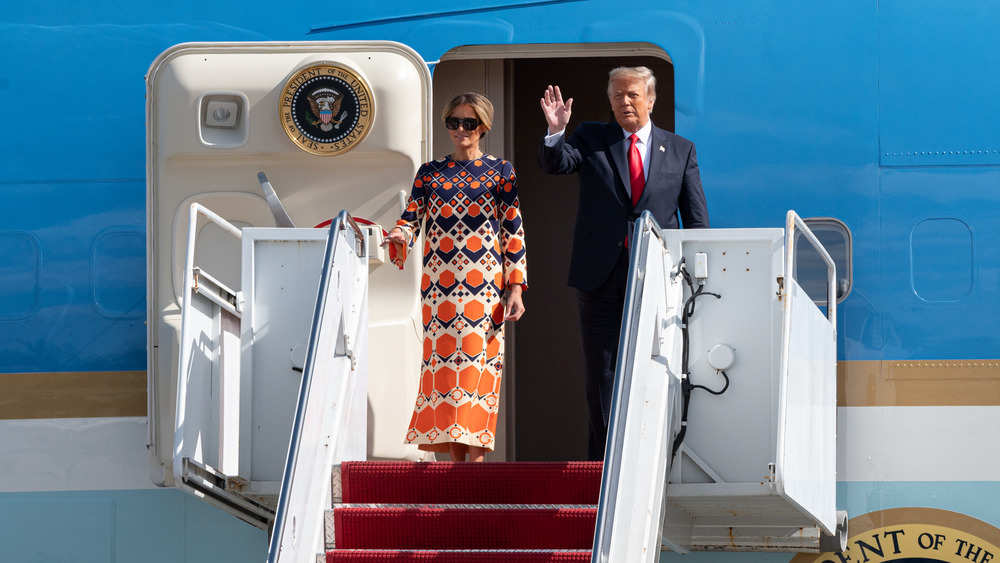 Donald and Melania Trump waving outside Air Force One