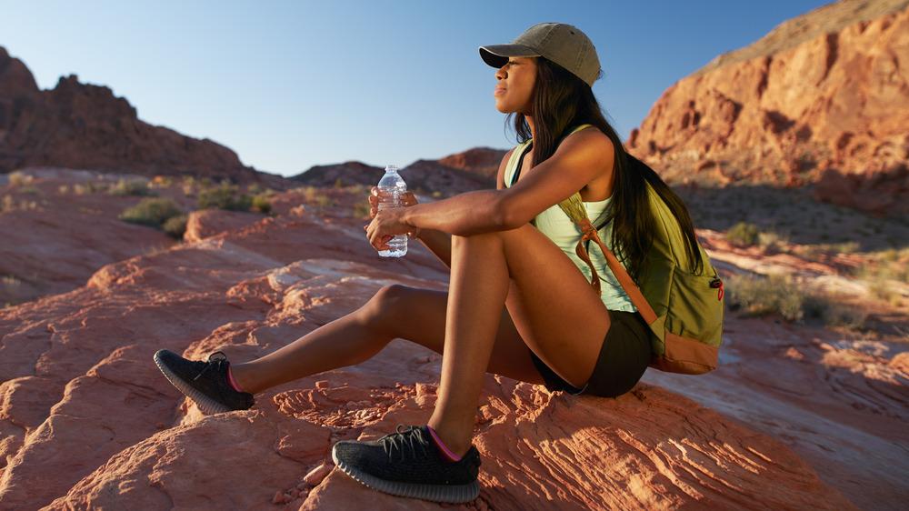 Woman hiker sitting