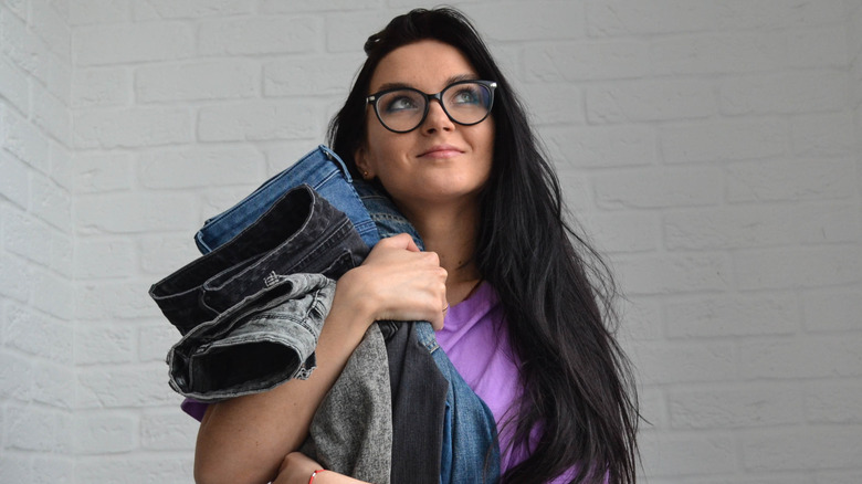 Woman holding her favorite jeans