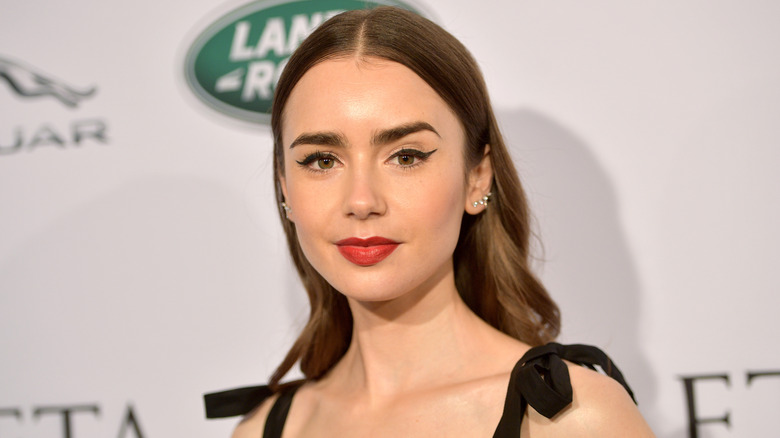 Lily Collins smizing on red carpet