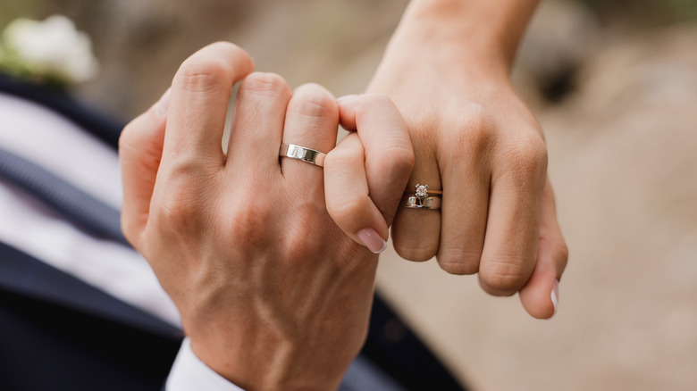 Couple with rings on their fingers
