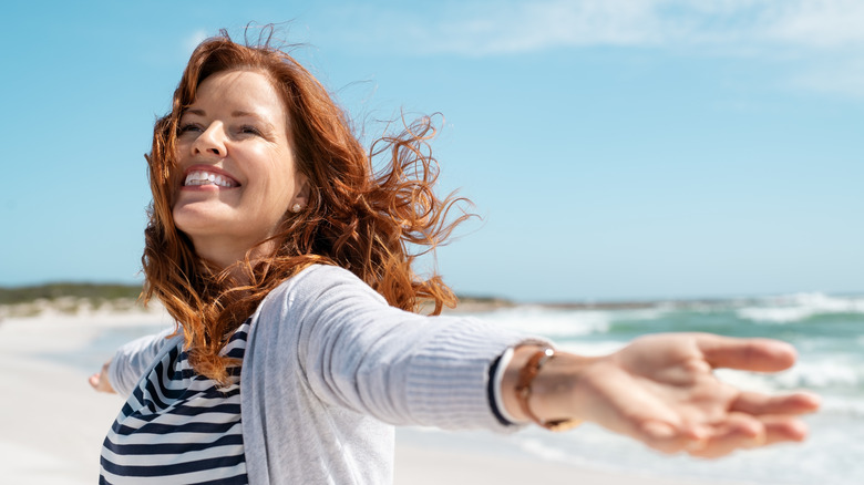 A happy woman on the beach