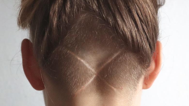 """An """"X"""" undercut in a woman's hair"""