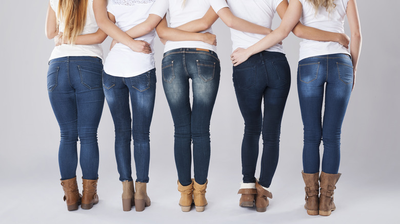 Women in skinny jeans and booties lined up