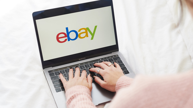 A woman searching on eBay