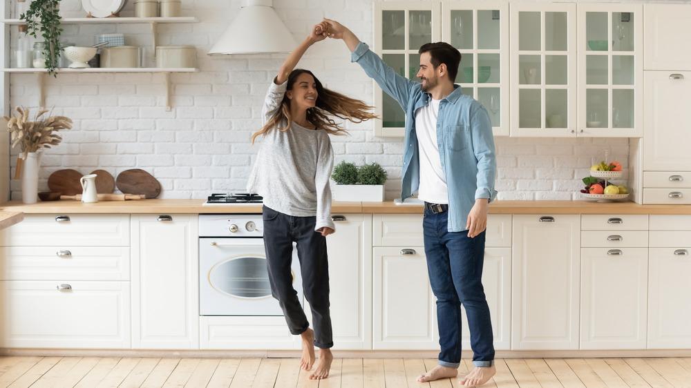 couple celebrating beautiful kitchen