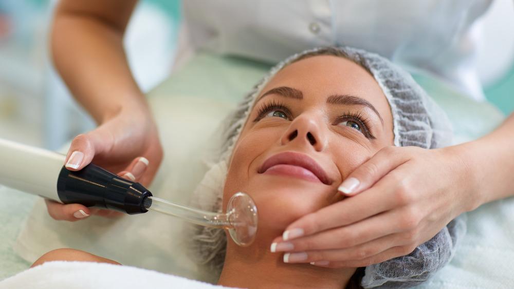 Woman receiving a spot removing treatment