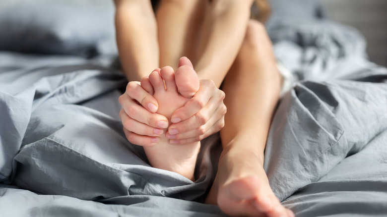 scratching foot in bed
