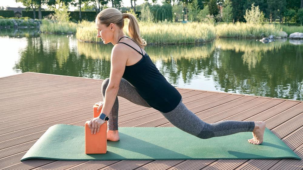 Woman doing yoga pose with blocks