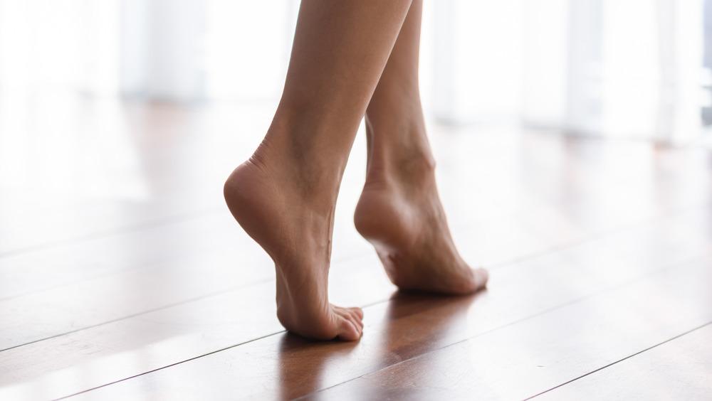 Bare feet walking or flexing