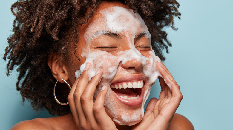 Woman using foaming cleanser