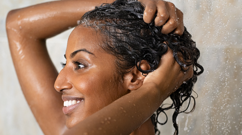 Woman with hair product in shower