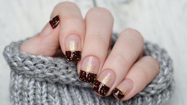 Negative space manicures use neutral polish to camouflage cuticle growth