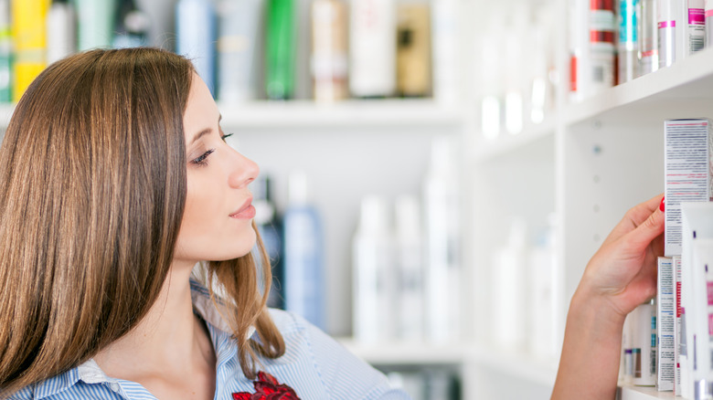 Woman shopping for drugstore beauty