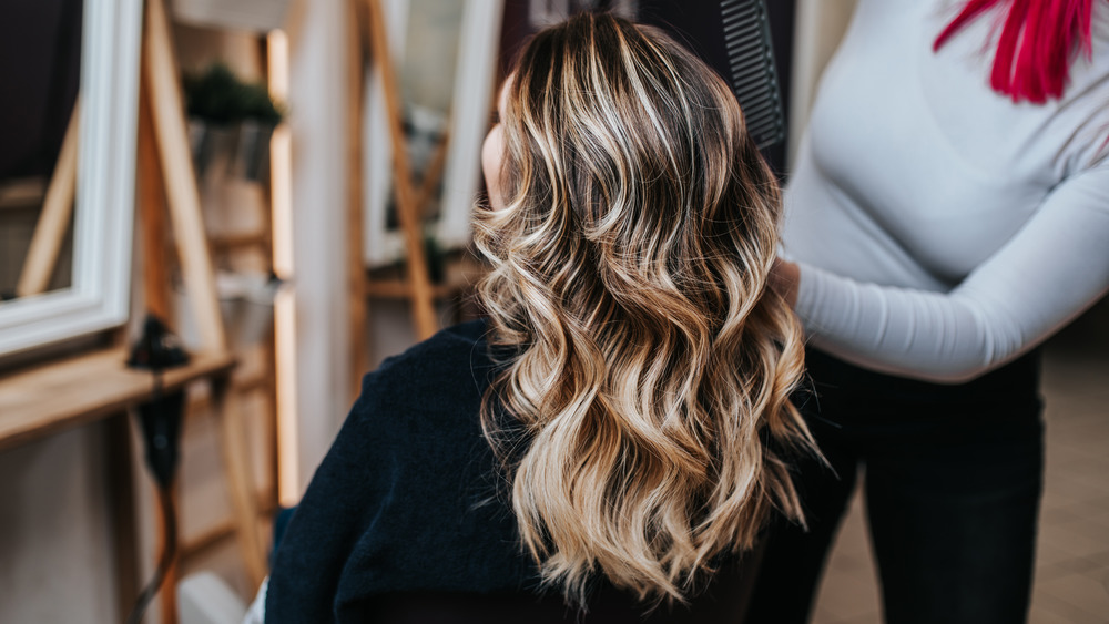 Blonde woman in a salon chair