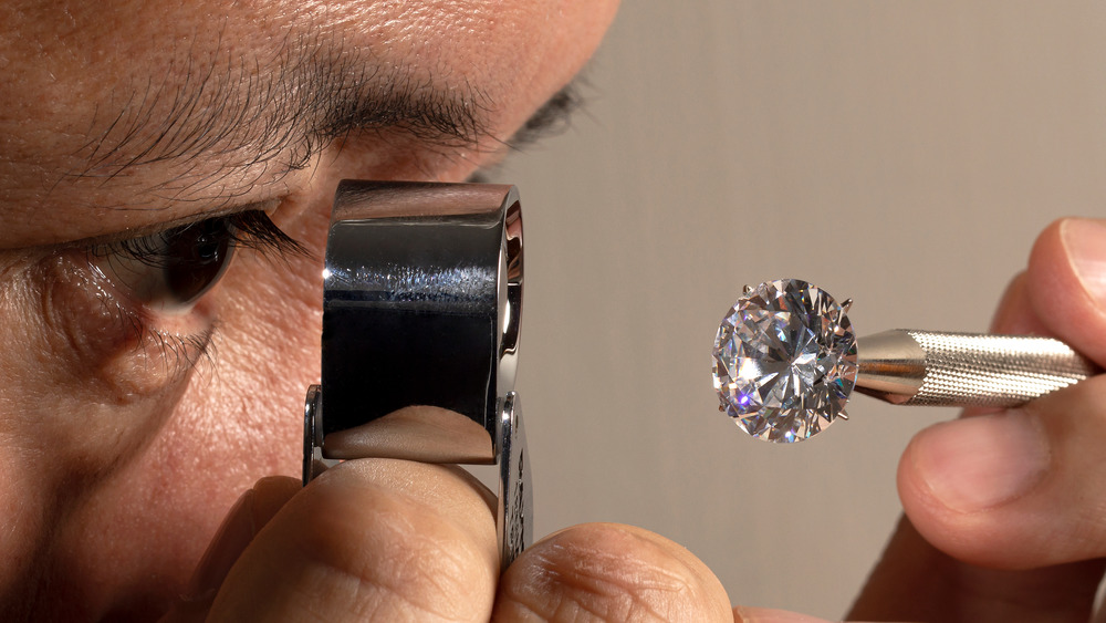 Man looking at a diamond