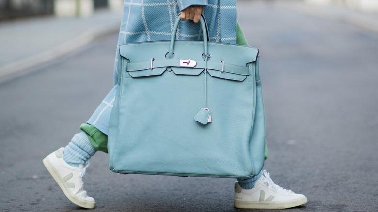 Woman carrying light blue Hermes Birkin bag