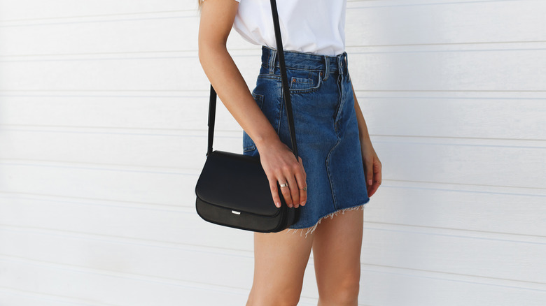 denim skirt with white shirt and purse