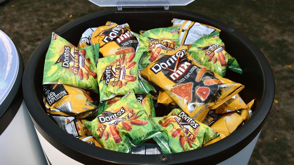Doritos bags in a barrel