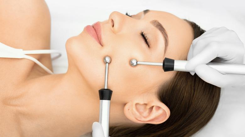 Woman having microcurrent treatment