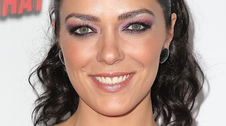 Adrianne Curry smiling for cameras