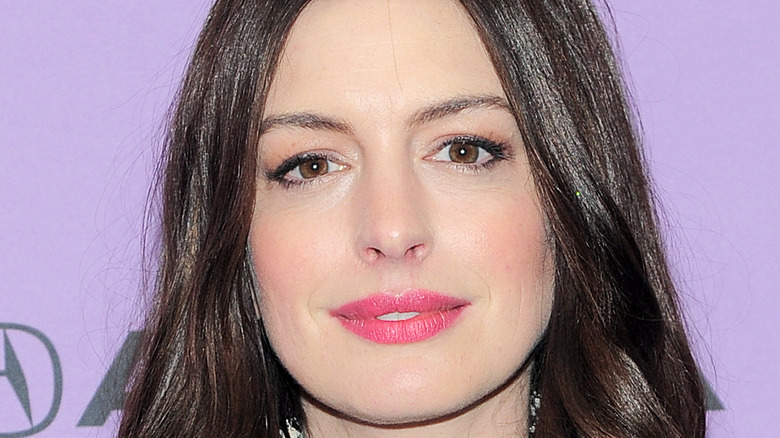 Anne Hathaway smiles at camera