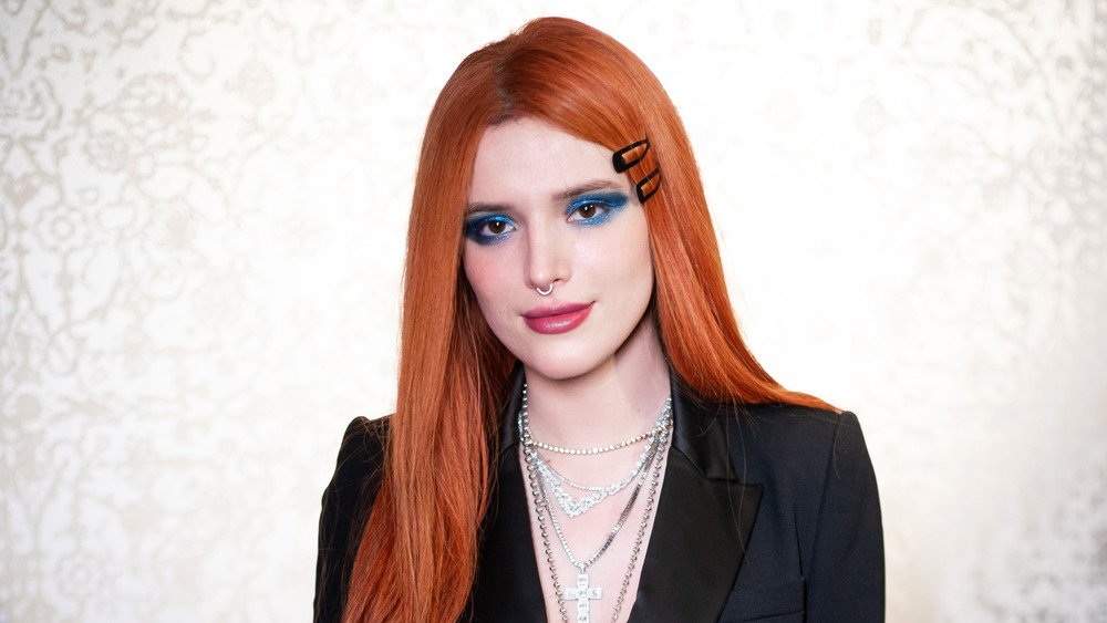 Bella Thorne poses on a red carpet