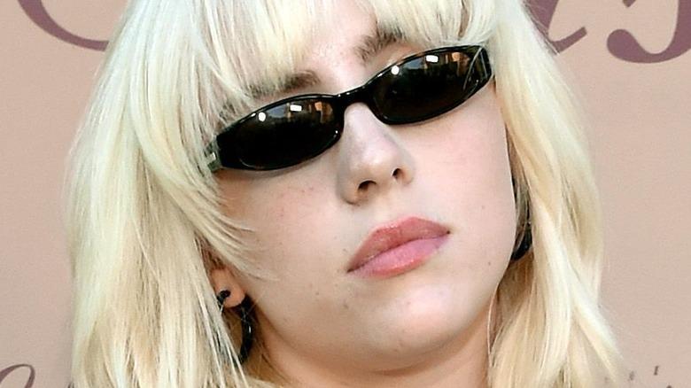 Billie Eilish posing with sunglasses