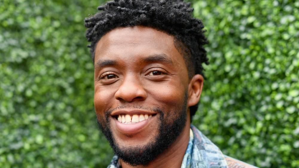 Chadwick Boseman smiles