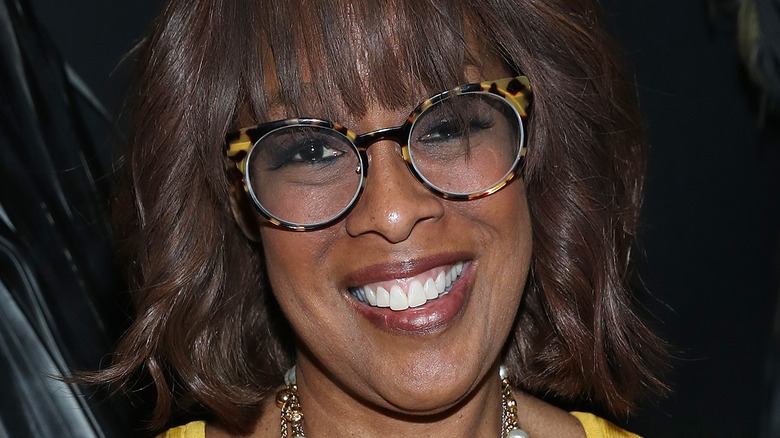 gayle king in 2020 wearing glasses and yellow dress
