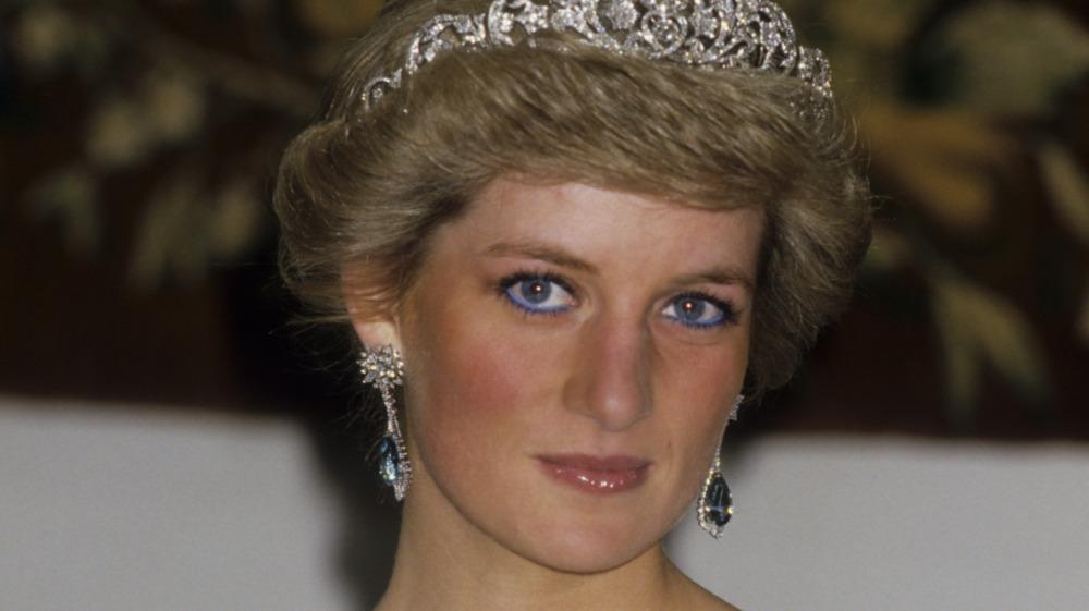 Princess Diana posing in crown