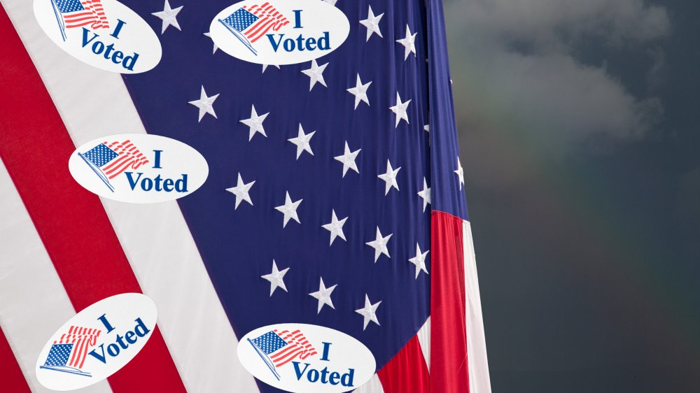 """American flag covered in """"I voted"""" stickers"""