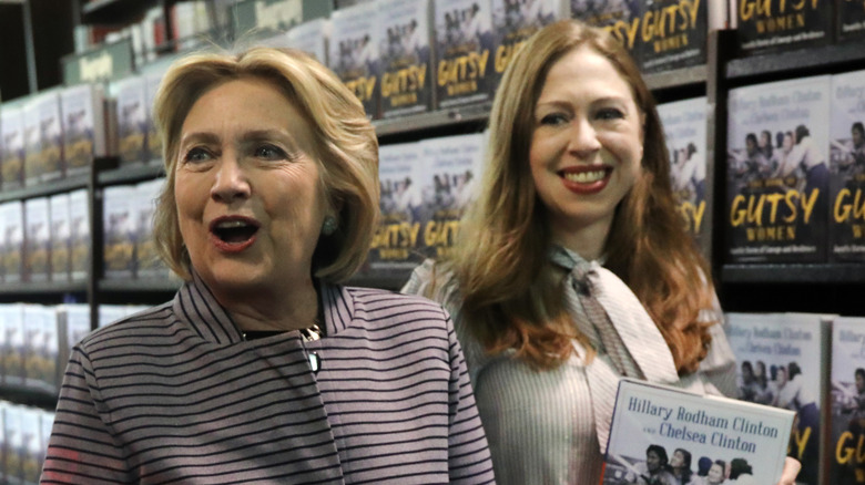 Hillary and Chelsea Clinton hold Gutsy Woman