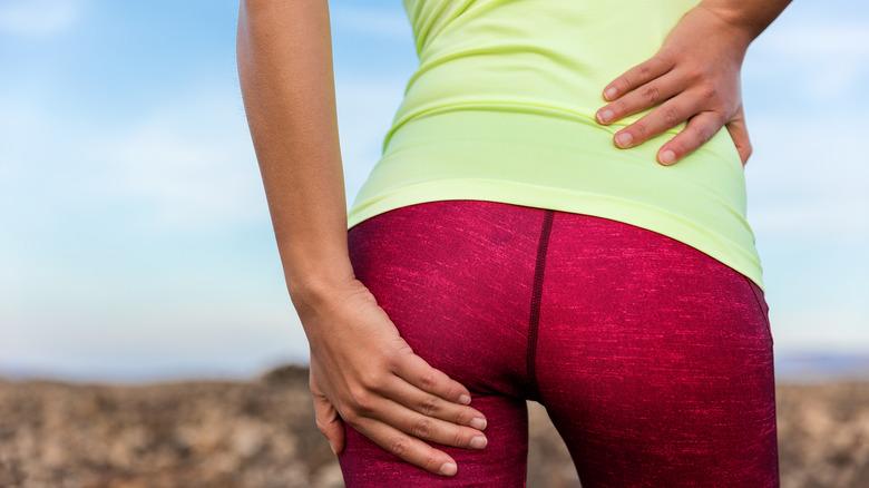 woman grabbing butt in leggings