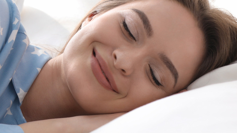 Happy woman dreaming