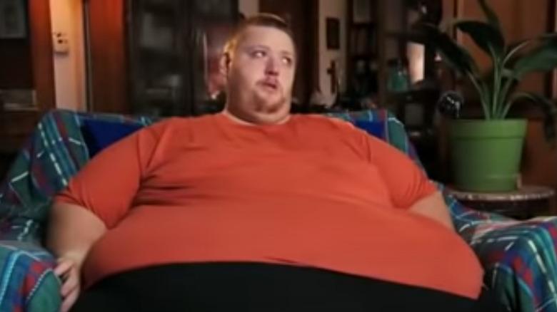 James Jones in an orange t shirt