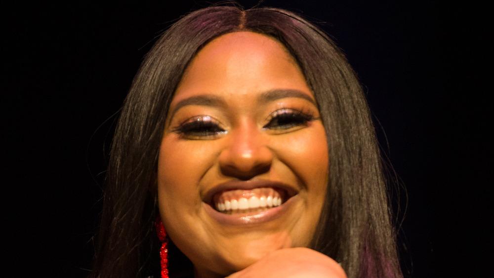 Jazmine Sullivan smiling at an event