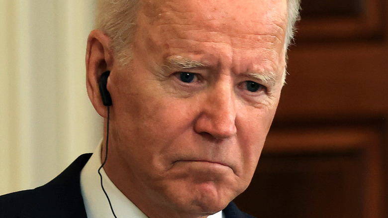 President Joe Biden listening to headphones