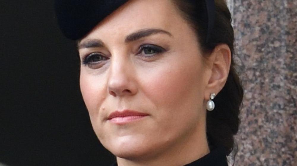 Kate Middleton looking serious in black