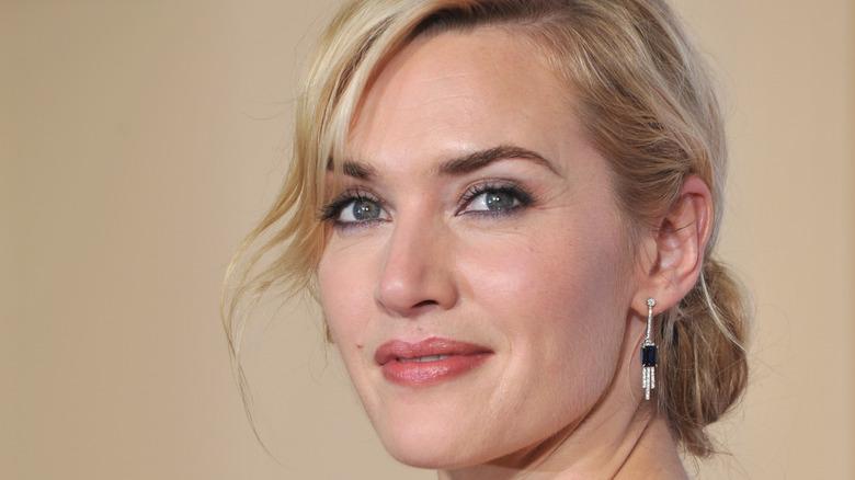 Kate Winslet smiling over the shoulder