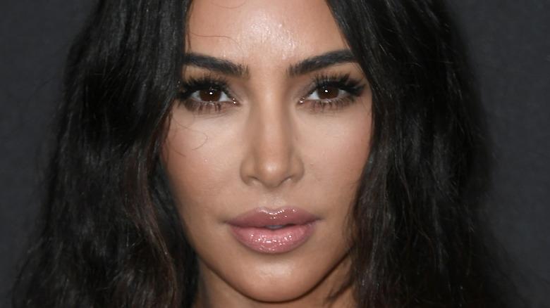 Kim Kardashian poses at an event.