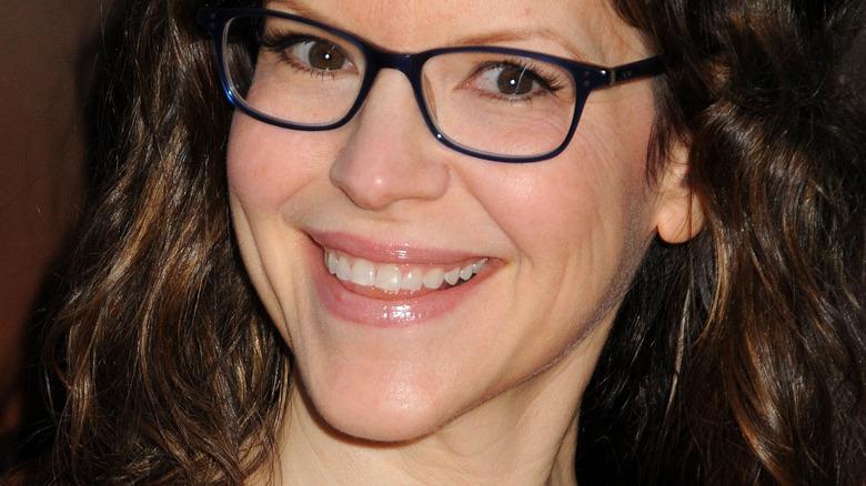Lisa Loeb smiles at camera