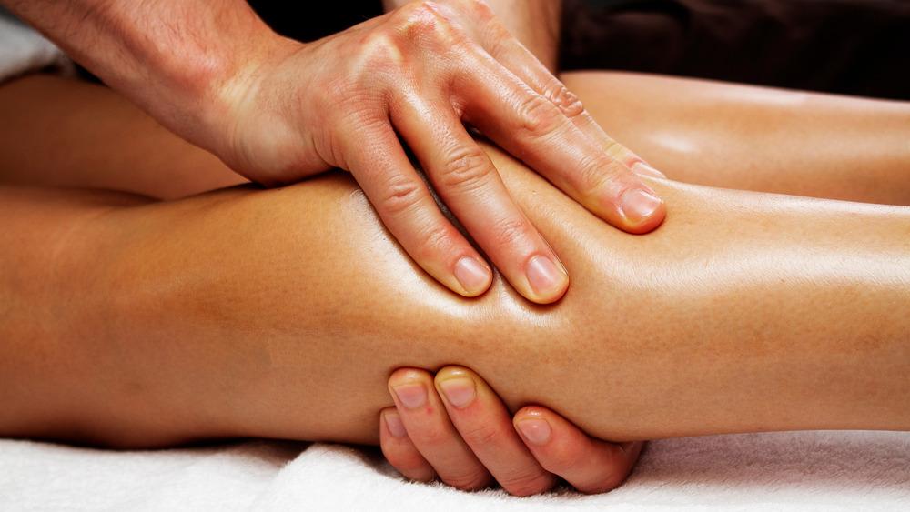 Hands massaging a leg