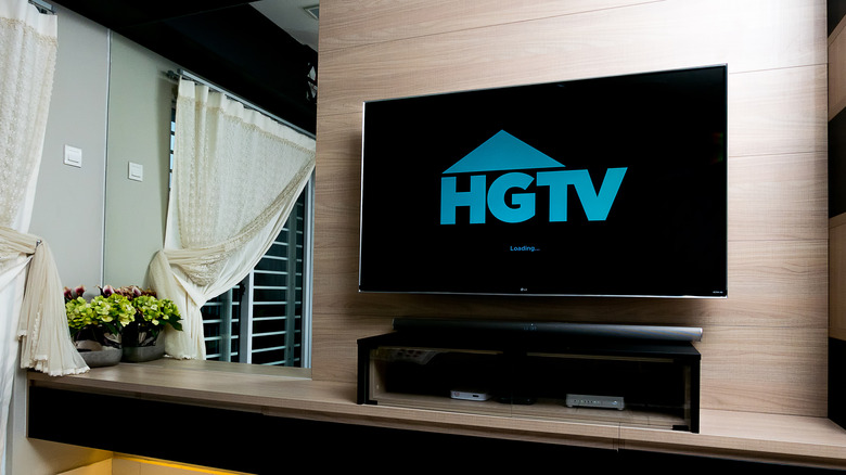 A TV with a large HGTV logo