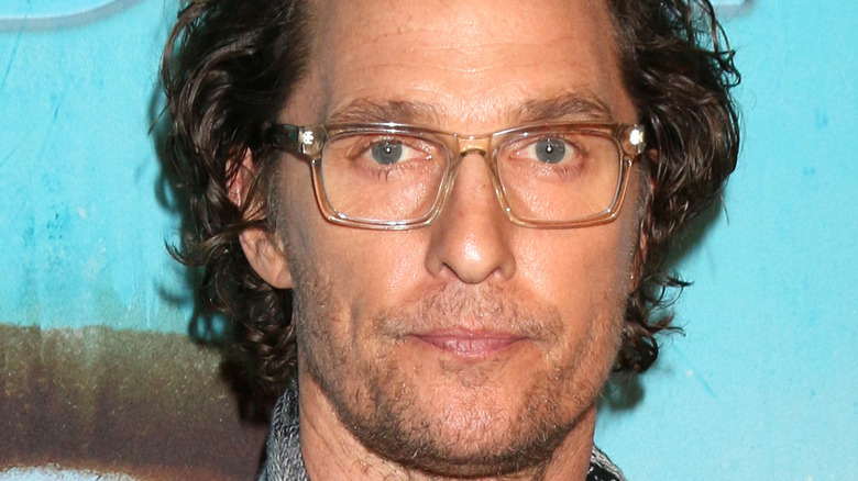 Matthew McConaughey wearing glasses at an event