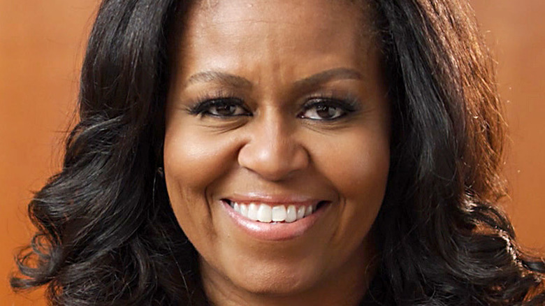 Michelle Obama smiles at an event