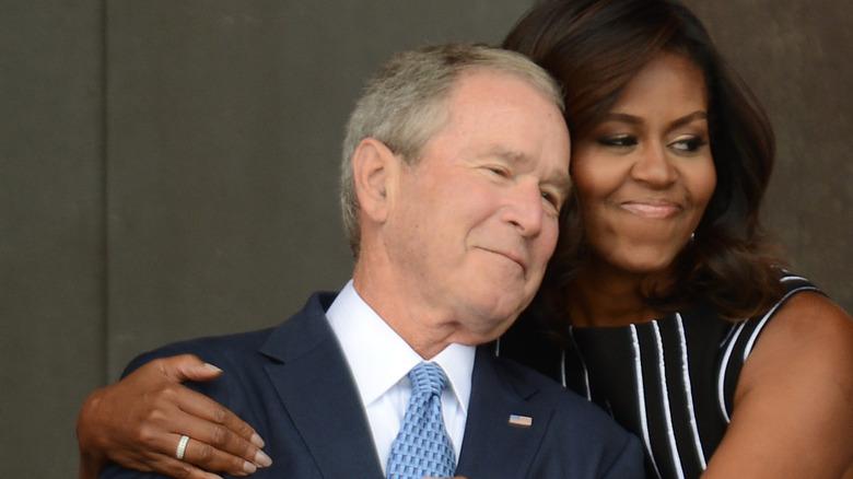 Michelle Obama and George W. Bush hugging
