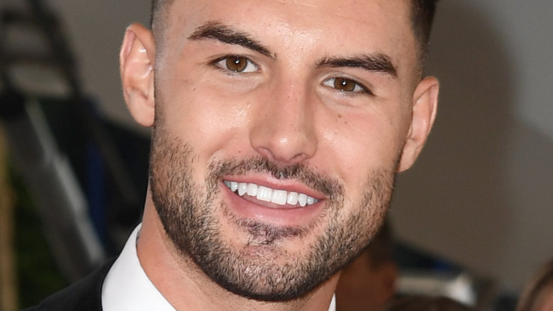 Liam Reardon smiling at an event